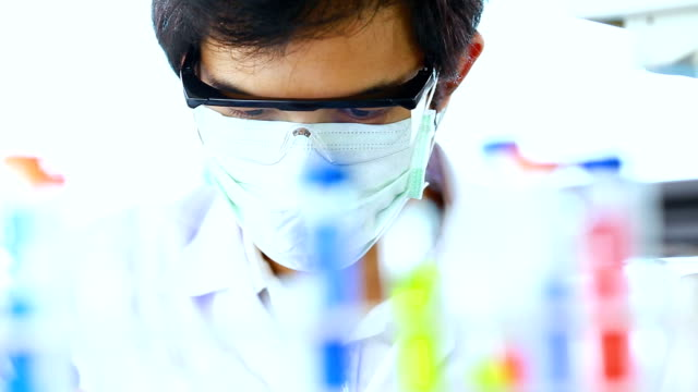 close up of scientist works in laboratory video