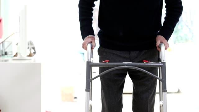 Close Up Of Senior Man Using Walking Frame At Home video