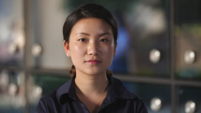Close up of Serious Young Chinese Woman in Slow motion ,4k