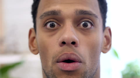 Close Up of Shocked, Wondering Afro-American Man Indoor Close Up of Shocked, Wondering Afro-American Man Indoor facial expression stock videos & royalty-free footage