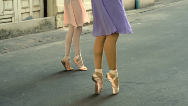 Close up of shoes ballerina dancing along the street