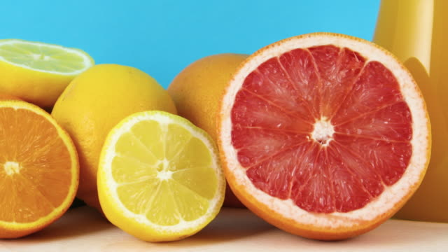 close up of sliced grapefruit, lemon and orange on blue background - icon set healthy video stock e b–roll
