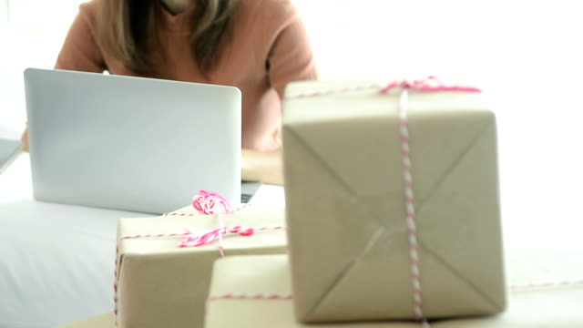 close up of smiling daughter helping her mother doing online shop business - holiday and invoice family video stock e b–roll