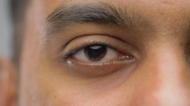 close up of south asian male eye with brown iris