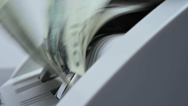 Close Up Of Spinning Mechanism Of Currency Counter Machine Totaling Paper Banknotes. Close Up Of Spinning Mechanism Of Currency Counter Machine Totaling Paper Banknotes. bank counter stock videos & royalty-free footage