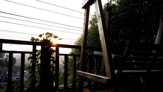 Close up of swinging bench at the terrace of an old house in Fenghuangs riverside video