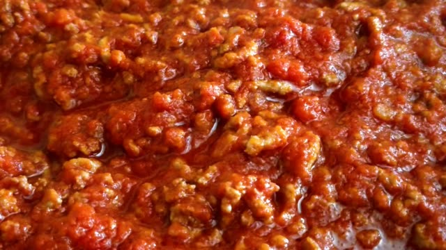 close up of tasty bolognese sauce (ragù alla bolognese). typical sauce for italian pasta - icona posate video stock e b–roll