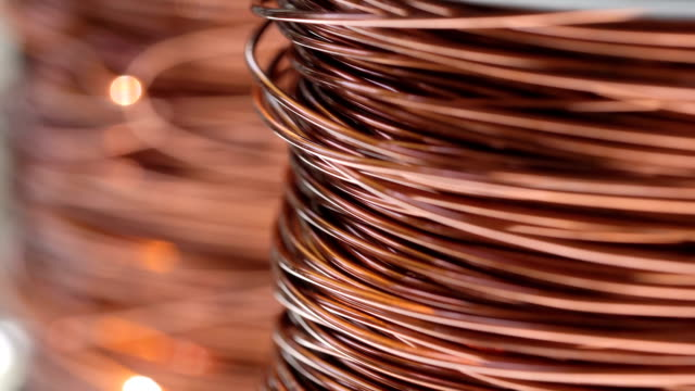 Close up of the bare bright copper wire on the spool, Rack focus Close up of the bare bright copper wire on the spool, Rack focus copper stock videos & royalty-free footage
