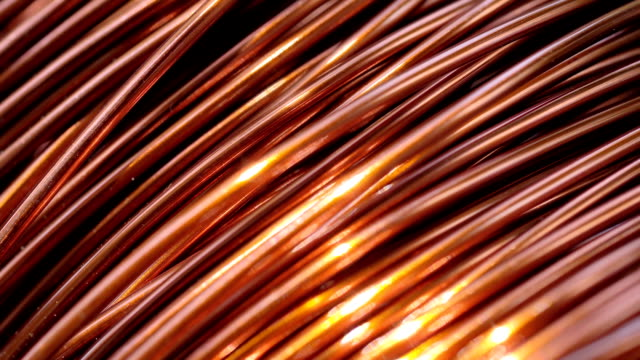 Close up of the bare bright copper wire on the spool