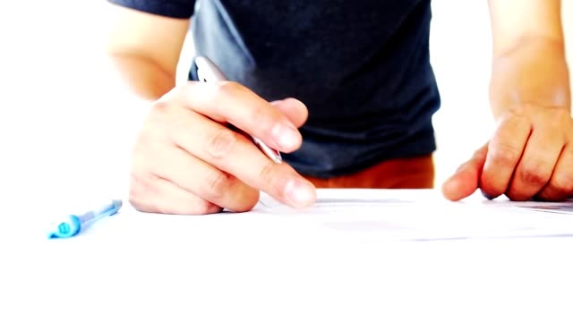 Close up of the businessman was hesitant to sign the contract. Businessman signing an official document. High key techniques video
