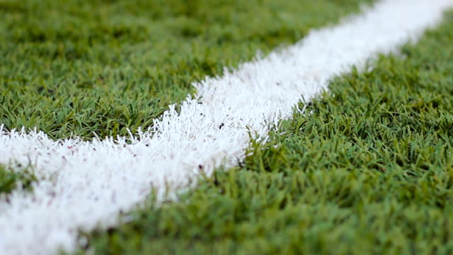 Close up  of the out of bounds  line on  a turf football field video
