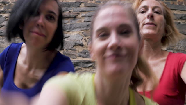Close up of three women competing to dance in front of the camera