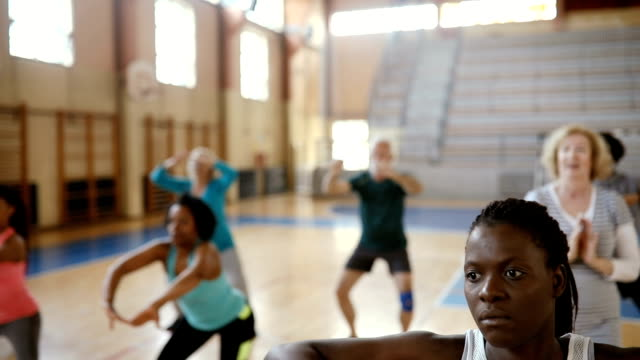 Close up of two women doing exercise at aerobic class