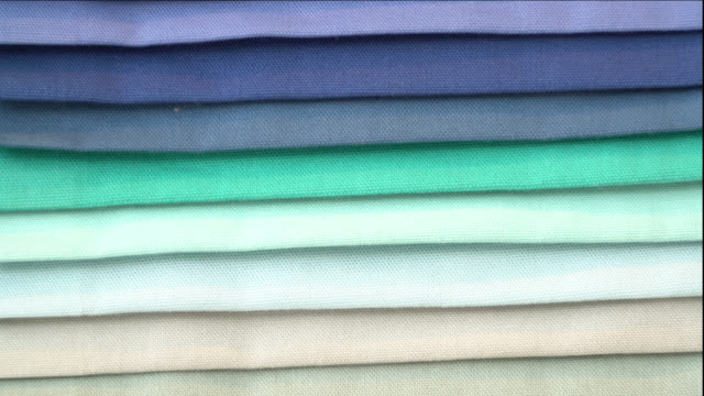 Close up of upholstery textile materials different shades of blue, white and green Close up of upholstery textile materials different shades of blue, white and green fabric swatch stock videos & royalty-free footage
