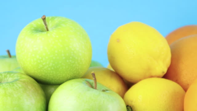 close up of various kind of organic and fresh fruits on blue background - icon set healthy video stock e b–roll