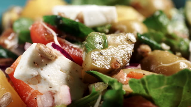 Close up of vegetables salad with cheese Close up of vegetables salad with green leaves lettuce, feta cheese, sliced tomatoes, olive and seeds sesame stock videos & royalty-free footage
