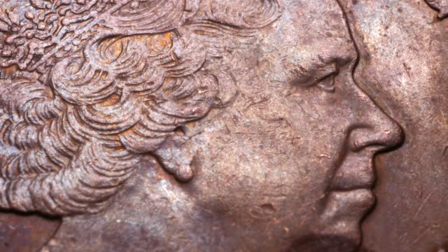 Close up of very old coins Close up of a detailed old coins us coin stock videos & royalty-free footage