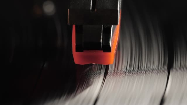 close up of vinyl record on dj turntable record player - disco audio analogico video stock e b–roll