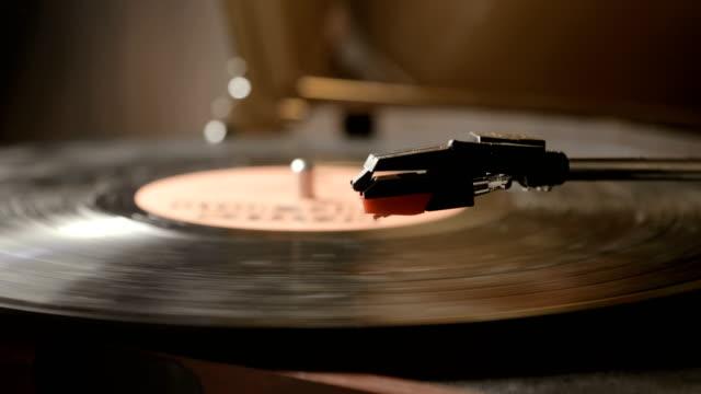 close up of vinyl record on dj turntable record player - adulazione video stock e b–roll