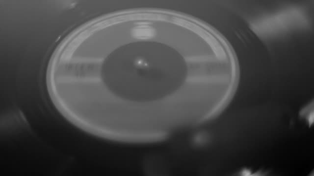 Close Up of Vinyl Record Spinning on Turntable