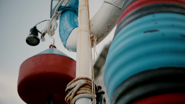 Close up of white life buoy and fishermans buoy Marine theme video