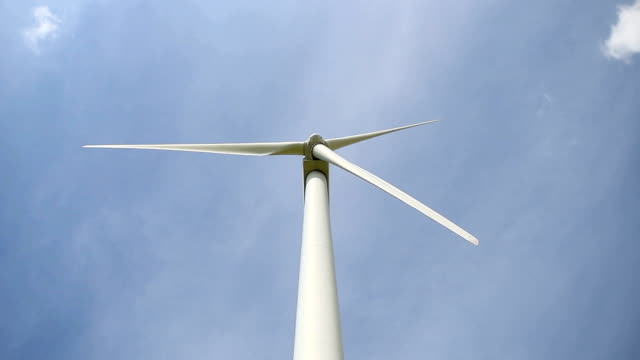 Close up of wind turbine propeller blades turning in the blue sky video
