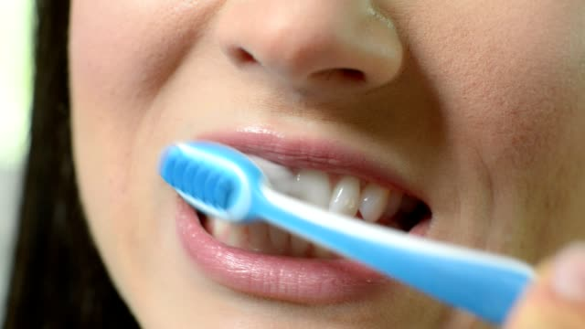 Close Up Of Woman Brushing Teeth With Manual Toothbrush video