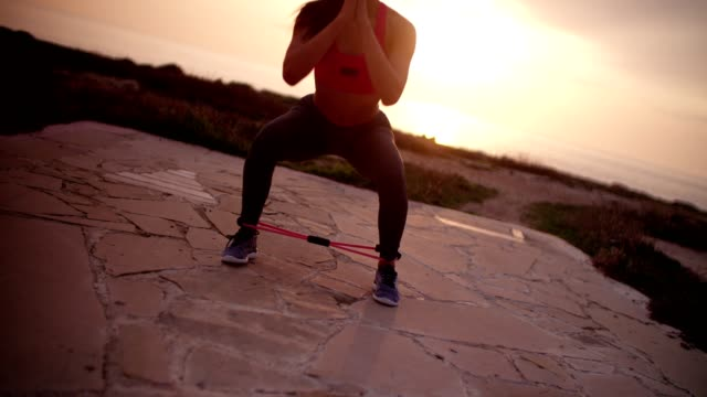 Close up of woman doing balance exercise with resistance band video