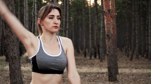 close up of woman doing sports exercises in fresh air - abbigliamento da neonato video stock e b–roll