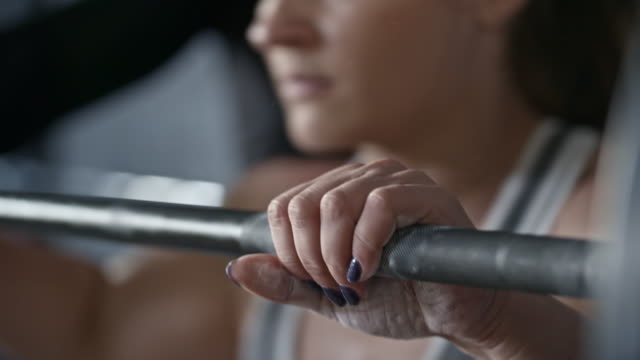 Close Up of Woman Gripping Barbell video