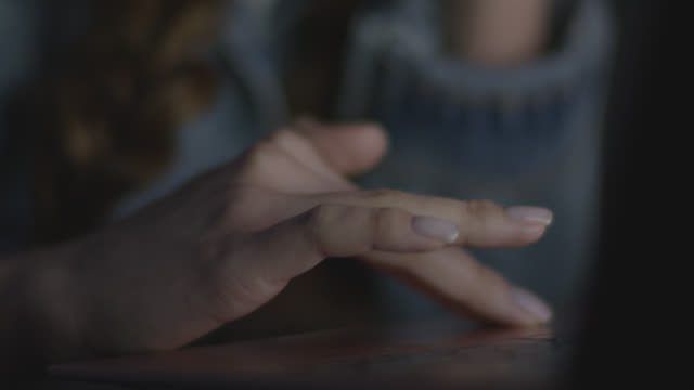 Close up of Woman hands using laptop computer, indoors