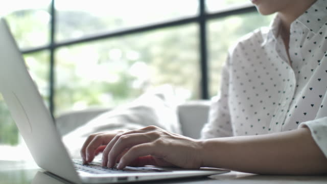 Close up of Woman hands using laptop computer