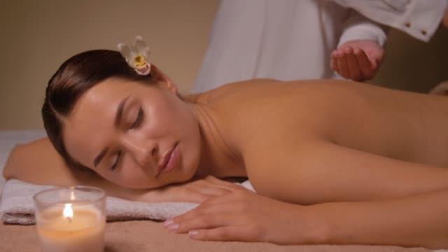 close up of woman having back massage at spa - china drug video stock e b–roll