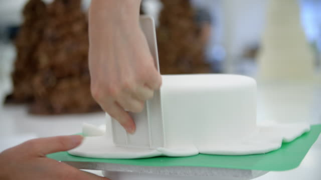 Close Up Of Woman In Bakery Decorating Cake video