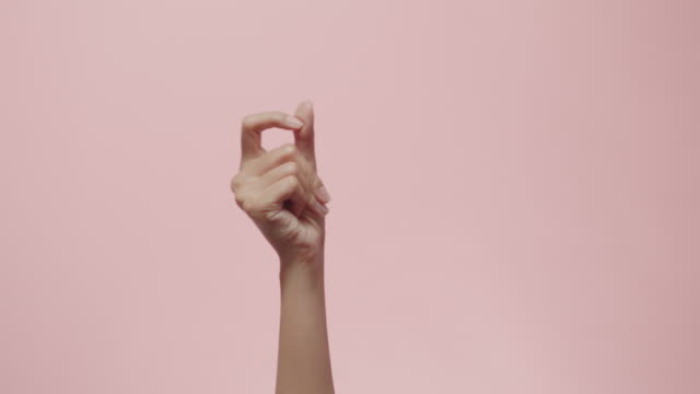 Close up of Woman's hand snapping her finger doing the hand gesture isolated on a pink studio background with copy space for place a text, message for advertisement, and promote your brand and product Close up of Woman's hand snapping her finger doing the hand gesture isolated on a pink studio background with copy space for place a text, message for advertisement, and promote your brand and product snapping stock videos & royalty-free footage