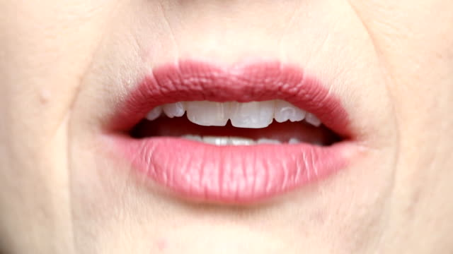 close up of woman's talking mouth front view - рот стоковые видео и кадры b-roll