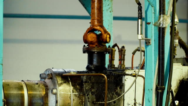 Close up of work of the production machine in the plant video