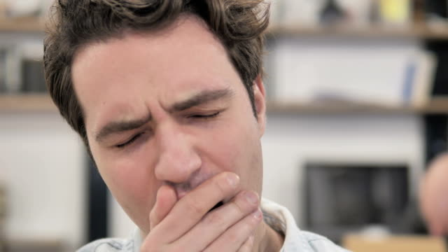 close up of yawning tired creative man at work - sonnecchiare video stock e b–roll