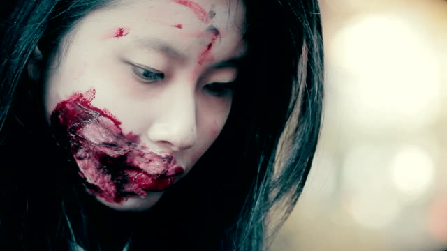 Close up of young female face with ugly bloody wound video