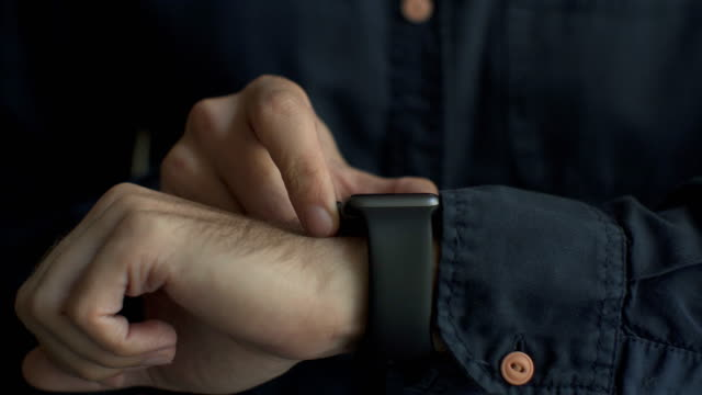 close up of young man using smartwatch - sports medicine stock videos and b-roll footage