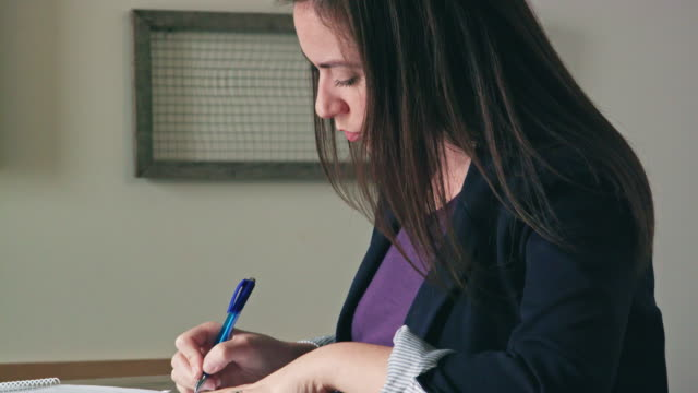 Close Up of Young Woman Writing on Documents video