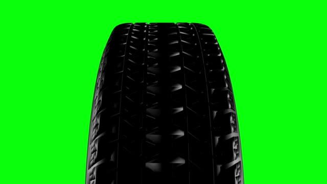 närbild på ett bildäck i rörelse. sömlös loop - wheel black background bildbanksvideor och videomaterial från bakom kulisserna