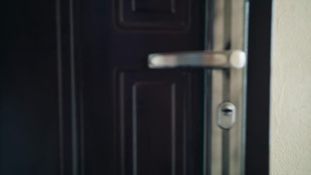 Close up on a door handle as the door is opened. Symbol of new hope, fresh starts and making an entrance Close up on a door handle as the door is opened. Symbol of new hope, fresh starts and making an entrance blackmagic ursa mini 4,6k handle stock videos & royalty-free footage