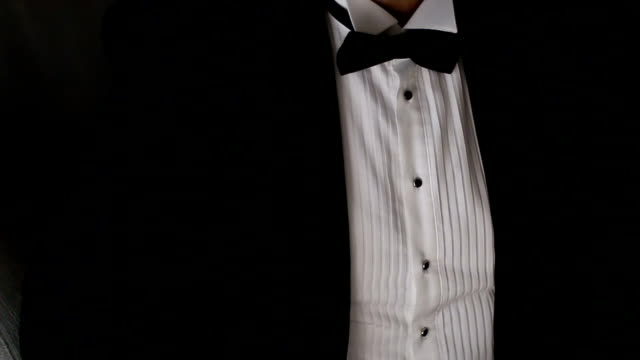 Close up on a man in tuxedo suit and bow tie video