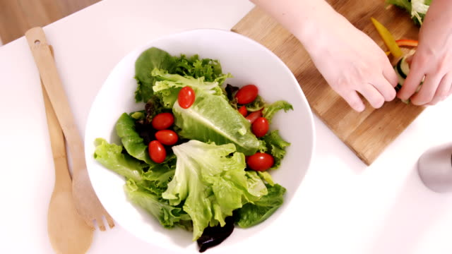 Close up on a woman preparing a salad video