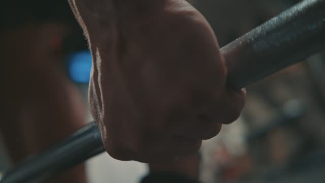 Close up on hands. Bodybuilder preparing to weight lifting. Muscular, fit, training, exercising, weight lifting, barbells / 4K Slow Motion Footage