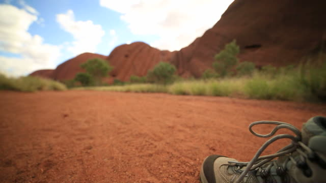 close up on hiker's boots walking - fare un passo video stock e b–roll