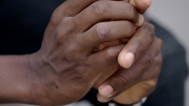 close up on lonely sad  black african migrant rubbing his hands.worries,troubles - unemployment stock videos & royalty-free footage