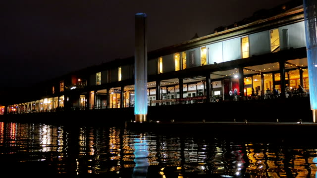 Close up on nightclubs illuminate the river channel- Bristol video