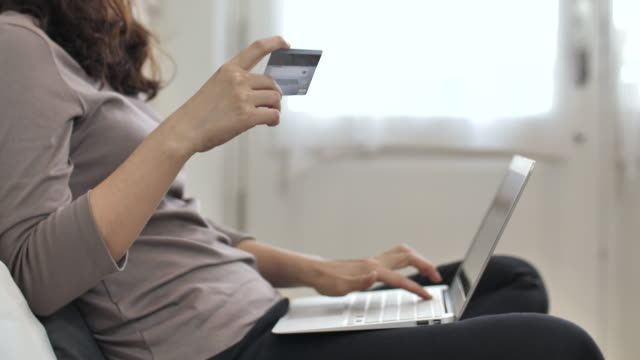Close up online shopping with credit card at home Close up online shopping with credit card at home credit card purchase stock videos & royalty-free footage